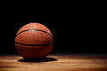 Basketball On A Hardwood Court Floor Stock Images - 75947634