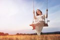 Young Woman On A Swing Royalty Free Stock Image - 75971166