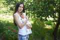 Summer Portrait Of A Young Mother With A Newborn Child Stock Image - 75973001