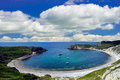 Lulworth Cove With Clouds Royalty Free Stock Image - 75974046