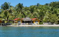 Waterfront Hostel Tropical Beach Coconut Trees Stock Image - 76038341