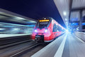 Modern High Speed Red Passenger Train At Night Stock Photography - 76083612