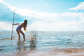 Girl With A Trident In His Hand Looks At The Sea Surface Stock Images - 76098694