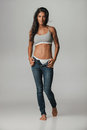 Grinning Young Woman In Unzipped Blue Jeans Royalty Free Stock Photos - 76104778