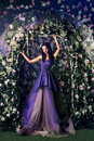 Woman Wearing Long Purple Dress Posing In The Flowered Garden Stock Photography - 76116832