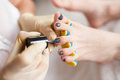 Pedicurist Applying Nail Polish, Close Up Photo Stock Photos - 76136893