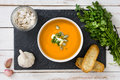 Pumpkin Soup On Slate Plate And A White Wooden Table Royalty Free Stock Photo - 76140275