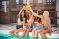 Four Girls Having Fun And Drinking Cocktails At Swimming Pool Stock Photography - 76170482