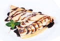 Pancakes Stuffed Bananas And Chocolate On A Plate Royalty Free Stock Photo - 76226115