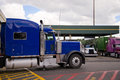 Blue Semi Truck Rig On Truck Stop Side View Royalty Free Stock Images - 76227649