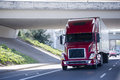 Red Modern Semi Truck With Reefer Trailer Under Bridge Royalty Free Stock Photo - 76227665