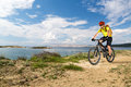 Mountain Biker Riding On Bike At The Sea And Summer Mountains. Stock Images - 76239074