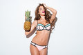 Young Smiling Pretty Sexy Girl Holding Pineapple And Posing Royalty Free Stock Photography - 76275587