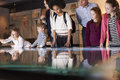 Pupils On School Field Trip To Museum Looking At Map Royalty Free Stock Images - 76294119