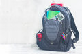 School Backpack With Supplies Stock Photo - 76373110