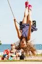 Playful Crazy Girl On Swing. Royalty Free Stock Photo - 76385915