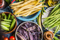 Colorful Pea And Bean Pods In Bowls, Top View, Close Up. Healthy Vegetarian Food Royalty Free Stock Photo - 76401035