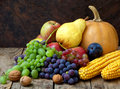 Still Life Of Autumn Fruits And Vegetables Like Grapes, Apples, Pears, Plums, Pumpkin, Corn Nuts Royalty Free Stock Photo - 76416975