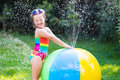 Little Girl Playing With Toy Ball Garden Sprinkler Royalty Free Stock Photography - 76418397