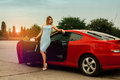 Sexy Young Lady On High Heels Near A Red Car Royalty Free Stock Images - 76455229