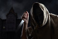 Hooded Man In Mask With A Knife Royalty Free Stock Photo - 76471185