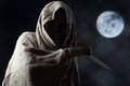Hooded Man In Mask With Knife Royalty Free Stock Photo - 76471405