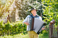Man In Traditional Bavarian Clothes Playing The Accordion Stock Photos - 76474063