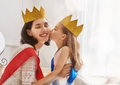 Queen And Princess In Gold Crowns Royalty Free Stock Image - 76480216