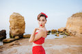 Happy Pretty Pinup Girl In Red Swimsuit Sending A Kiss Royalty Free Stock Photo - 76503155