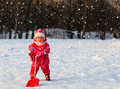 Cute Little Toddler Girl Dig Winter Snow Royalty Free Stock Photography - 76506567