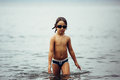 Wet-haired Kid In Goggles Walking In Sea Stock Images - 76516434