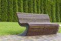 Stylish Curve Shaped Brown Wooden Bench Outdoor Furniture In The Park As Background Image Royalty Free Stock Photography - 76520317