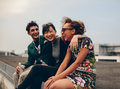 Friends Laughing Together On Rooftop Royalty Free Stock Images - 76528679