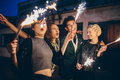 Young People Enjoying New Years Eve With Fireworks Stock Image - 76528831