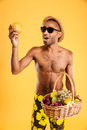 Young Afro American Man In Swimwear Holding Fruit Basket Stock Photography - 76556482
