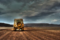 Land Rover Defender On Deserted Road At Dusk Stock Photography - 76572022