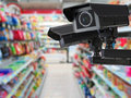 Cctv Camera Or Security Camera On Retail Shop Blurred Background Stock Image - 76595691