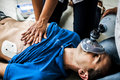 People Assisting An Unconscious Man Royalty Free Stock Image - 76606926