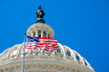 American Flag Waving In Front Of The Capitol In Washington D.C. Stock Images - 76626334