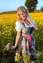Pretty Young German Oktoberfest Blonde Woman Wearing A Dirndl Royalty Free Stock Images - 76629999