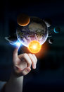 Businesswoman Touching Solar System With His Fingers Stock Photo - 76659540