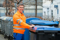 Working Man Standing Near Dustbin On Street Stock Images - 76665034