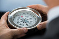 Close-up Of Person Hand With Compass Stock Photography - 76665492