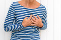 Woman Suffering Severe Chest Pains Royalty Free Stock Image - 76680756