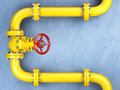 Yellow Gas Pipeline Valve On A Blue Wall. Space For Text. Royalty Free Stock Photos - 76695468