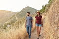 Nice Young Couple Strolling Down Mountain Stock Photo - 76699670