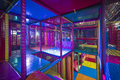 Kids Running Inside A Colorful Indoor Playground Stock Photos - 76701083