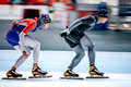 Two Men Skaters Race Behind Other Stock Photo - 76735970