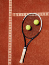 Close Up Of Tennis Racket And Yellow Balls At Red Clay Stock Photography - 76738222