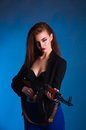 Girl Fashion Photography In The Studio With A Gun Is Dangerous Stock Photography - 76756642